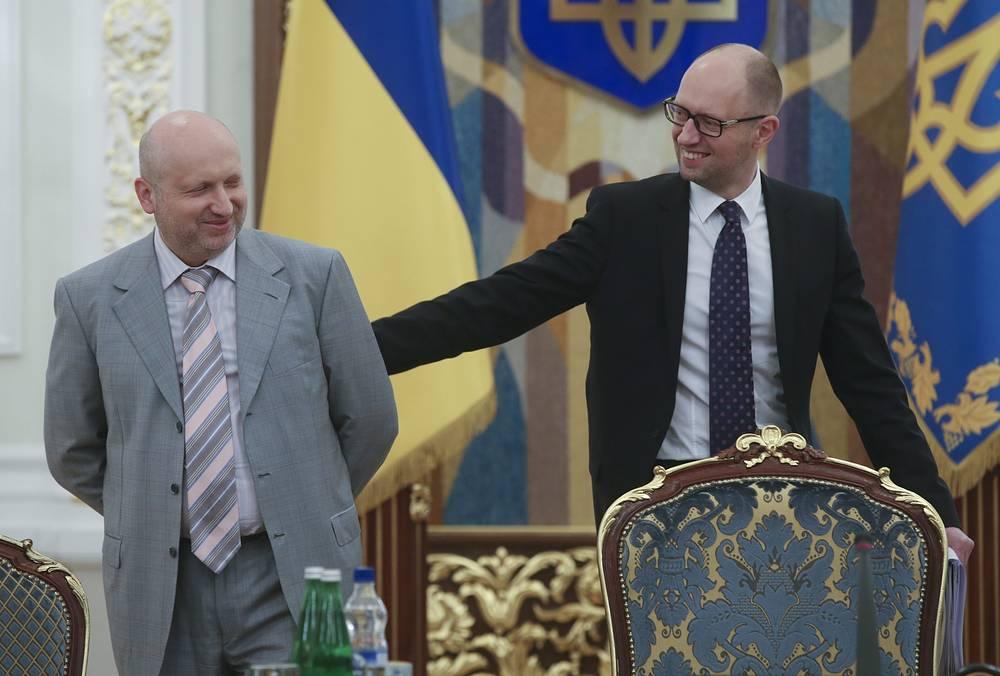 Verkhovna Rada Speaker Oleksandr Turchynov (L) and Arseniy Yatsenyuk