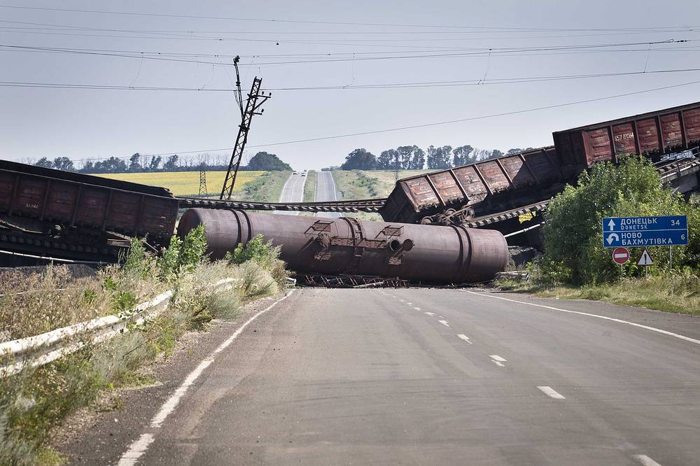 A blown-up railway bridge blocking the road between Kharkiv and Donetsk