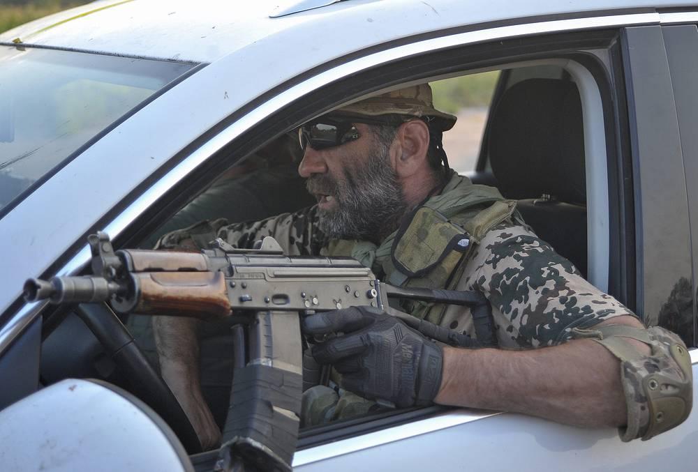 A soldier of Ukrainian battalion 'Donbas' drives a car in Luhansk Region