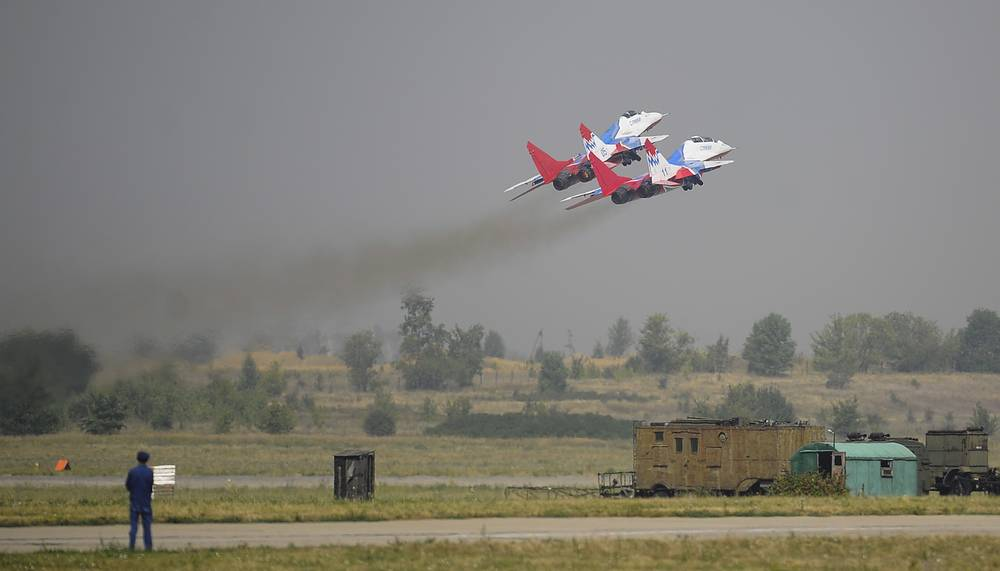 The Strizhi (Swifts) aerobatic team performs during the Russian Air Force Day celebration