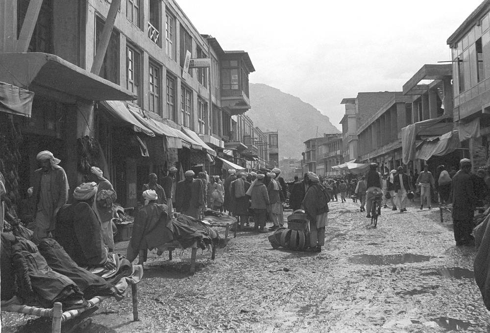 After the coup in 1973 Afghanistan was declared a republic. Photo: a street lined with tiny shops in the center of old Kabul, 1973