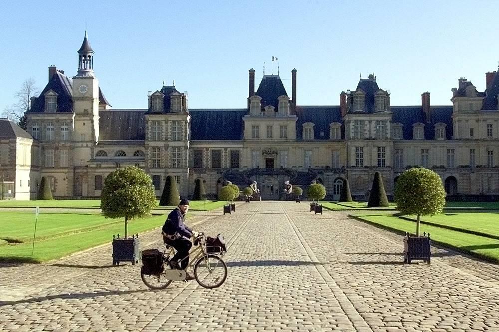 A postman on a bike, France