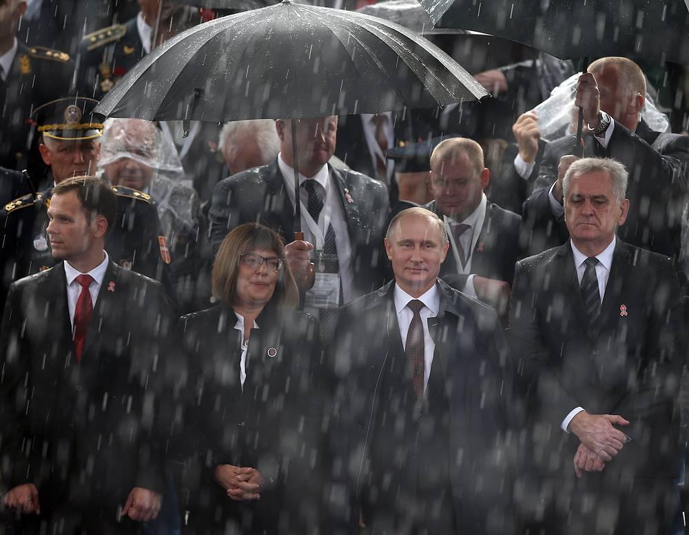 Vladimir Putin and Tomislav Nikolic attend a military parade in Belgrade, Serbia, 16 October 2014