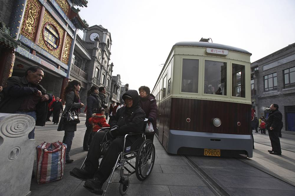 Photo: a tram running through the 600-year-old Qianmen Street in Beijing, China, 2009. Two trams started its service along the 840 meters long street to bring back memories of the tram service that ran from 1924 to 1960's