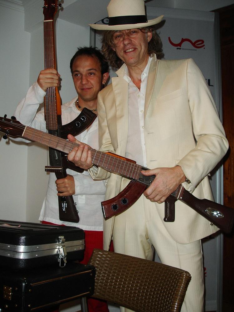 Photo: Irish musician Bob Geldof receives an Escopetarra, a Kalashnikov rifle that has been converted into a guitar, from Colombian musician Cesar Lopez, Colombia, 2007