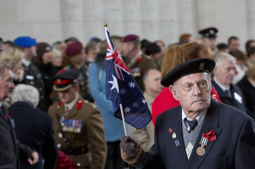 Photo: Poppy parade during an Armistice Day ceremony at the Menin Gate in Ypres, Belgium. The Menin Gate Memorial  bears the names of more than 54,000 British and Commonwealth soldiers who were killed in the Ypres Salient of World War I and whose graves are not known