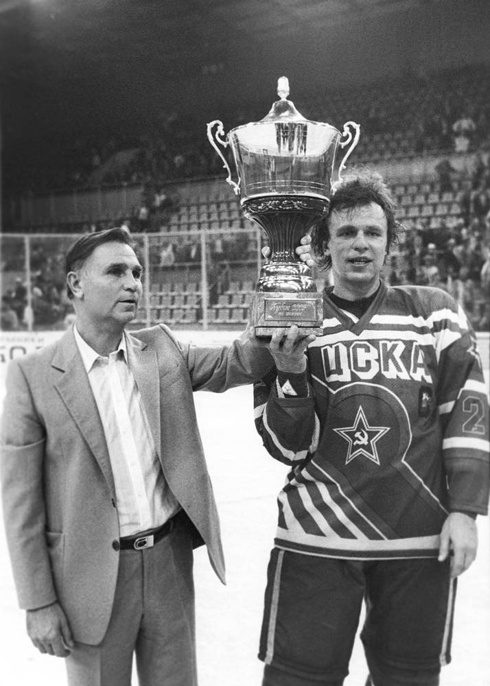 Viktor Tikhonov and CSKA team captain Vyacheslav Fetisov with the Soviet ice hockey cup, 1988