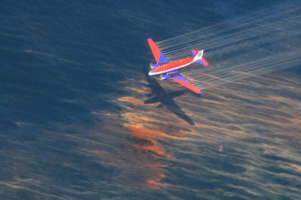 The accident triggered the worst oil spill in US history, killing uncountable numbers of birds and sea animals and bringing down fishery in the region. Photo: Aaircraft releasing oil dispersant over oil spill from the mobile offshore drilling rig Deepwater Horizon in the Gulf of Mexico, USA