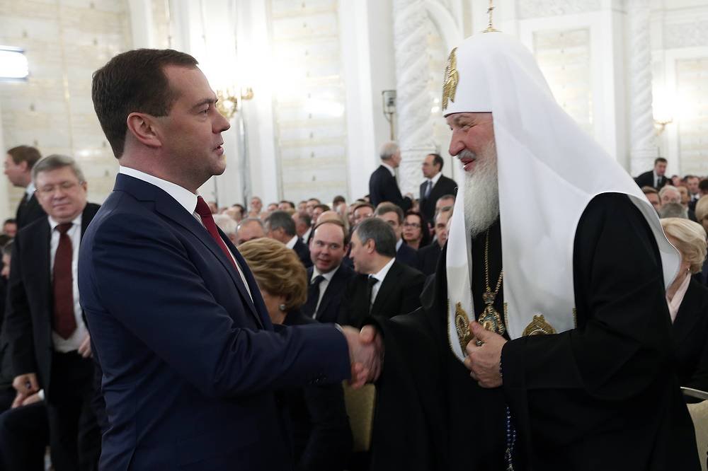 About 1,000 people, lawmakers, heads of traditional confessions, public figures and heads of the largest media holdings gathered in St. George Hall of the Grand Kremlin Palace. Photo: Russian Prime Minister Dmitry Medvedev and Patriarch Kirill, of Moscow and All Russia