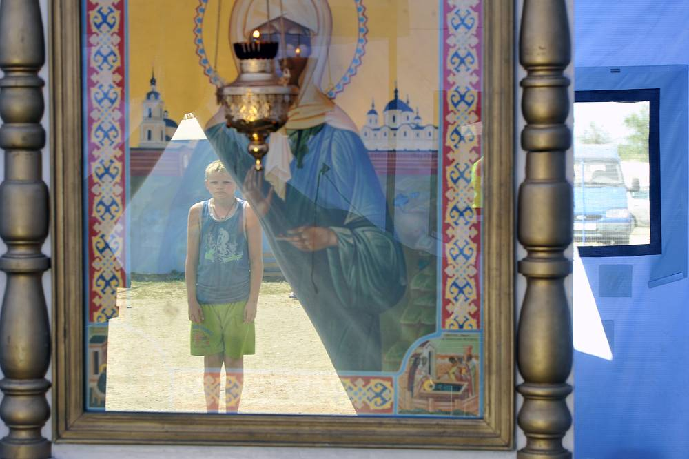 A boy looks at an icon at a refugee camp in south Russia's Rostov Region