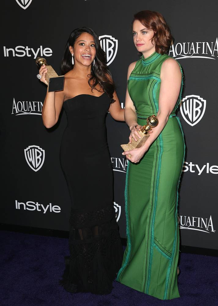 """Gina Rodriguez, winner of the award for Best actress in a television series - musical or comedy for """"Jane the Virgin"""", left, and Ruth Wilson, winner of the award for best actress in a television series - drama for """"The Affair"""""""
