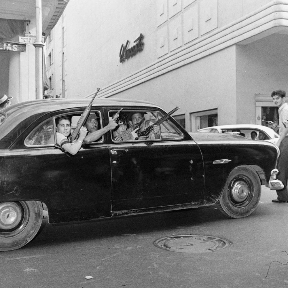 In a response US government  took a number of measures against Cuba including an embargo on exports to that country except for food and medicine. Photo: Rebels in the car on Havana's street, 1959