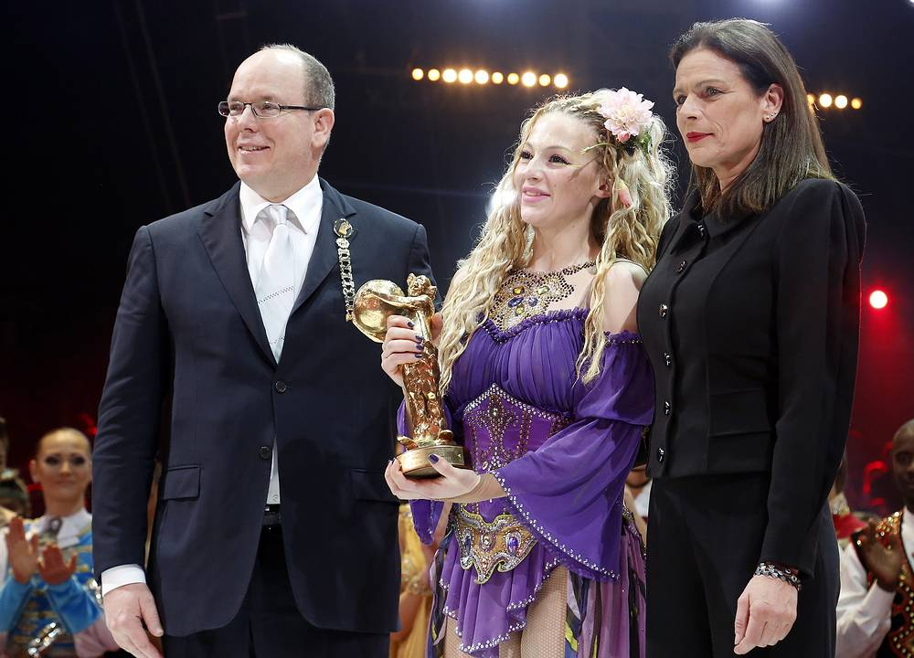 Russian artist Anastasia Fedotova-Stykan (center), Prince Albert II of Monaco (left) and Princess Stephanie (right) after receiving a Golden Clown during the Award Gala evening of the 39th Monte Carlo International Circus Festival, Monaco
