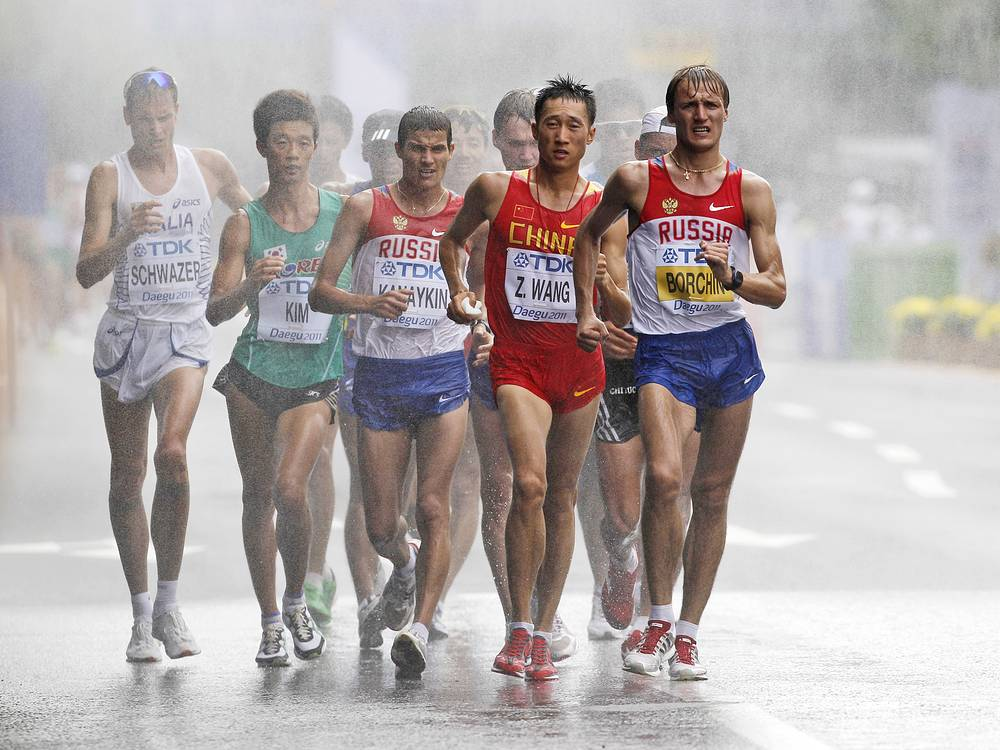 Valery Borchin, an Olympic gold medalist in 2008, was banned for eight years from October 2012 for a second doping offense. Photo: Russia's Valeriy Borchin (right), China's Wang Zhen, Russia's Vladimir Kanaykin, South Korea's Kim Hyunsub and Italy's Alex Schwazer compete in the Men's 20km Race Walk at the World Athletics Championships in Daegu, South Korea, 2011