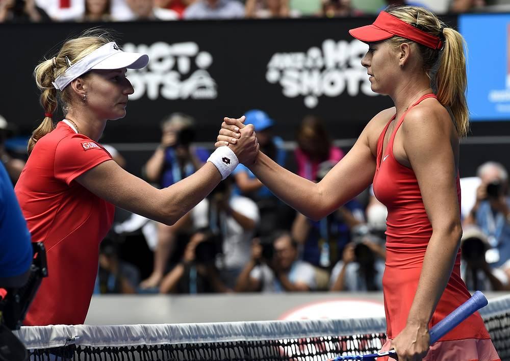 Photo: Maria Sharapova (right) is congratulated by Ekaterina Makarova at the net after winning semifinal match at the Australian Open 2015