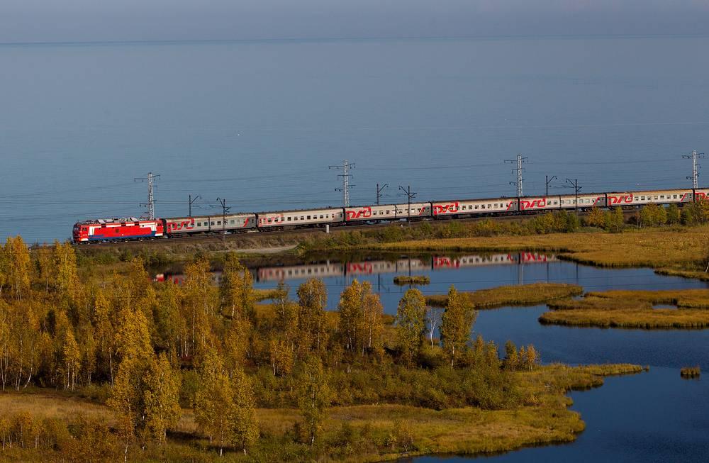 Photo: Train running along the shore of lake Baikal between Baikal station and Slyudyanka town. This route is the part of Trans-Siberian Railway