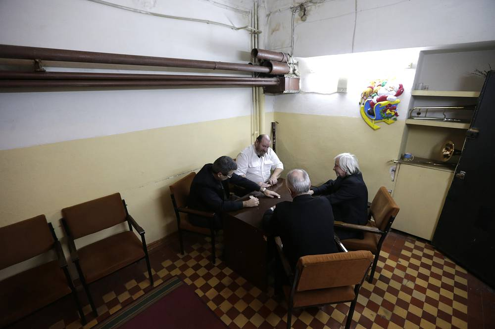 Musicians with the Donbas Opera Theater play dominos before the performance