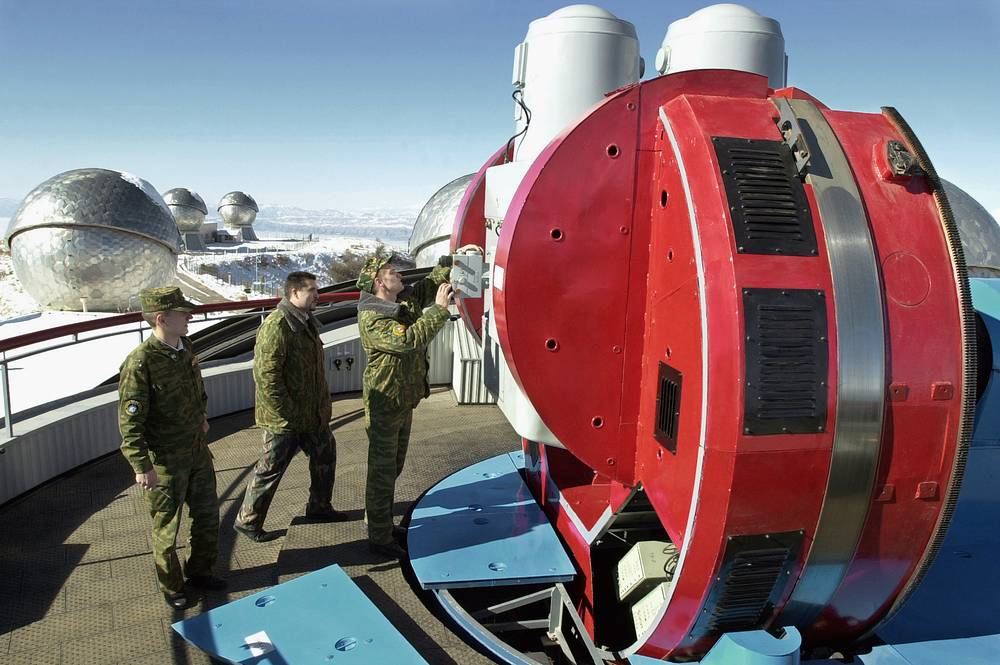 Servicemen of Russian Space troops ajusting telescopes of space surveillance station Okno (Window). The complex is located 2200 metres above sea level in Nurak, Tajikistan