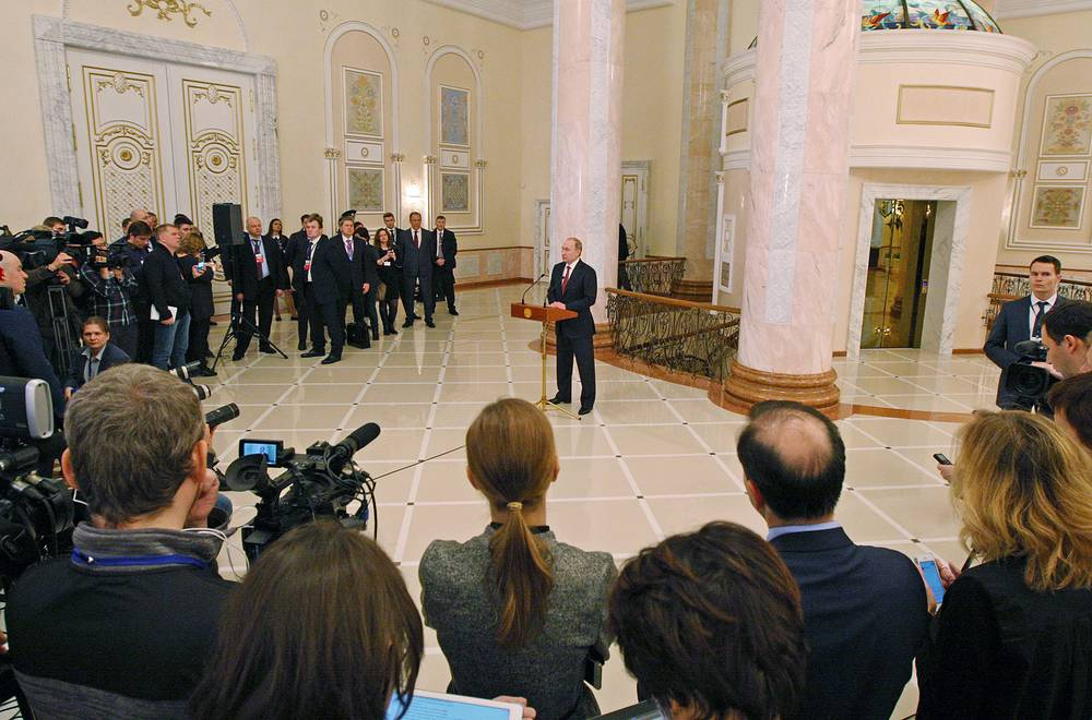 Russia's president Vladimir Putin giving a press conference following Ukraine peace talks at the Palace of Independence in Minsk