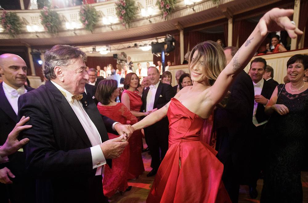 Vienna Opera Ball usually attracts local guests along with celebrities and international dignitaries. Photo: Italian model Elisabetta Canalis dancing with Austrian businessman Richard Lugner at the Vienna Opera Ball