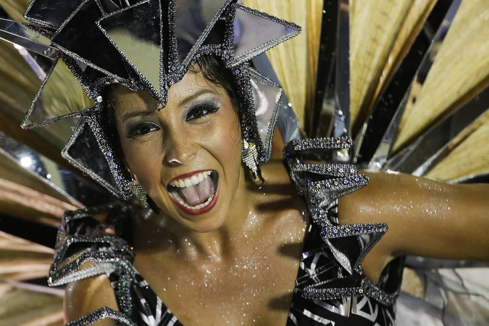 A performer from the Salgueiro samba school parades during carnival celebrations at the Sambadrome in Rio de Janeiro, Brazil