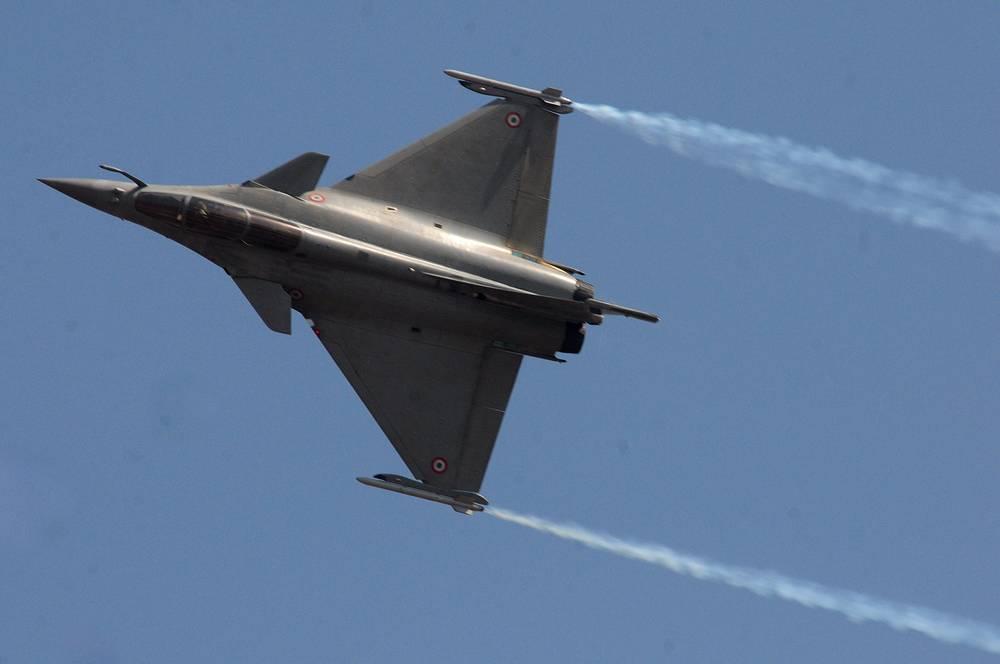 US fighter aircraft F-16 performing aerobatics at the opening of Aero India 2015 at the Yelahanka air base in Bangalore