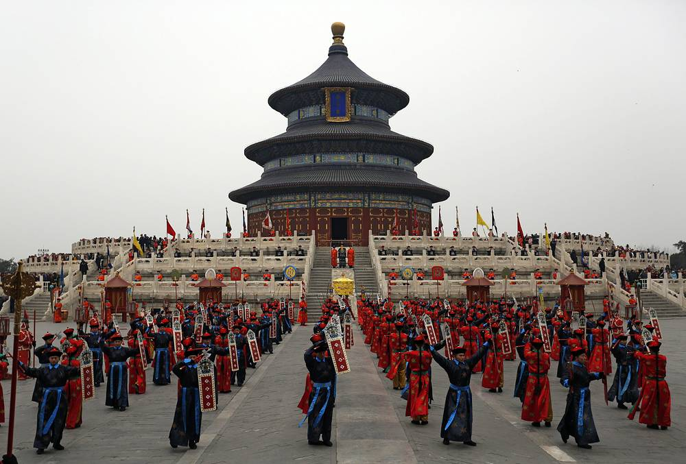 Chinese performers in Qing dynasty imperial costumes performing a re-enactment of the Sacrifice to Heaven ritual at the Temple of Heaven on the first day of the Chinese Lunar New Year in Beijing, China