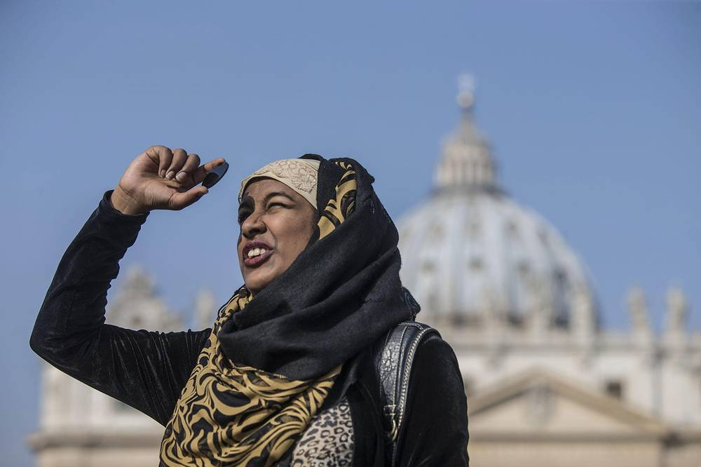 A woman observing the solar eclipse in St Peter Square, Vatican City