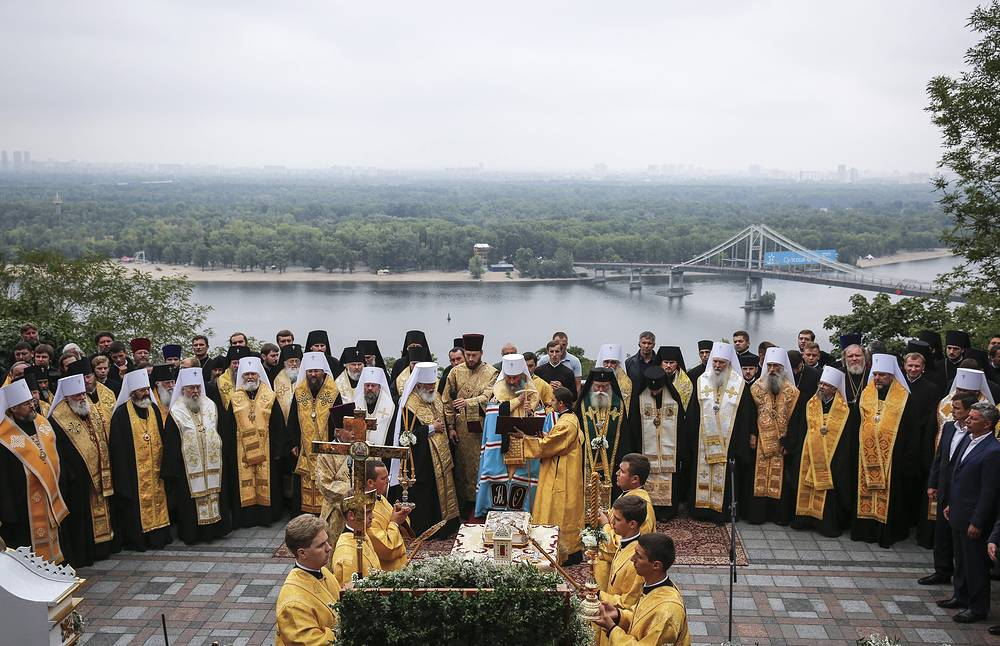 Priests from the Ukrainian Orthodox Church of Moscow participating in a prayer service at St. Vladimirs Hill in Kiev