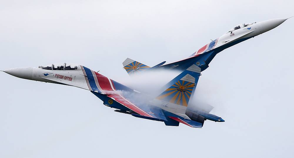 The Russkiye Vityazi (Russian Knights) aerobatic team performing a demonstration flight at the 2015 International Army Games