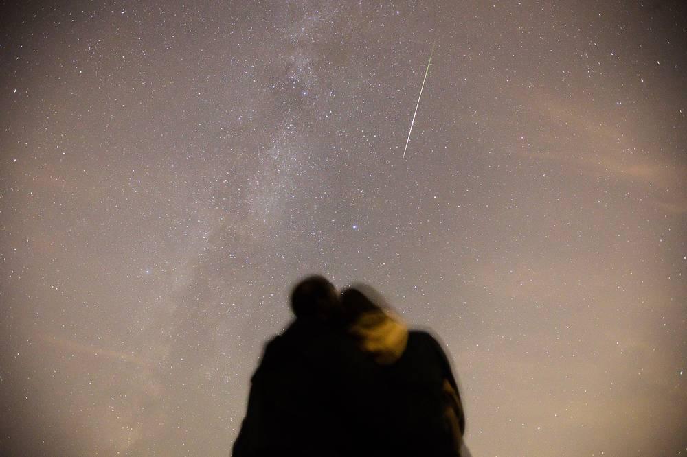 Couple watching Perseid meteor shower in Kazan, Russia