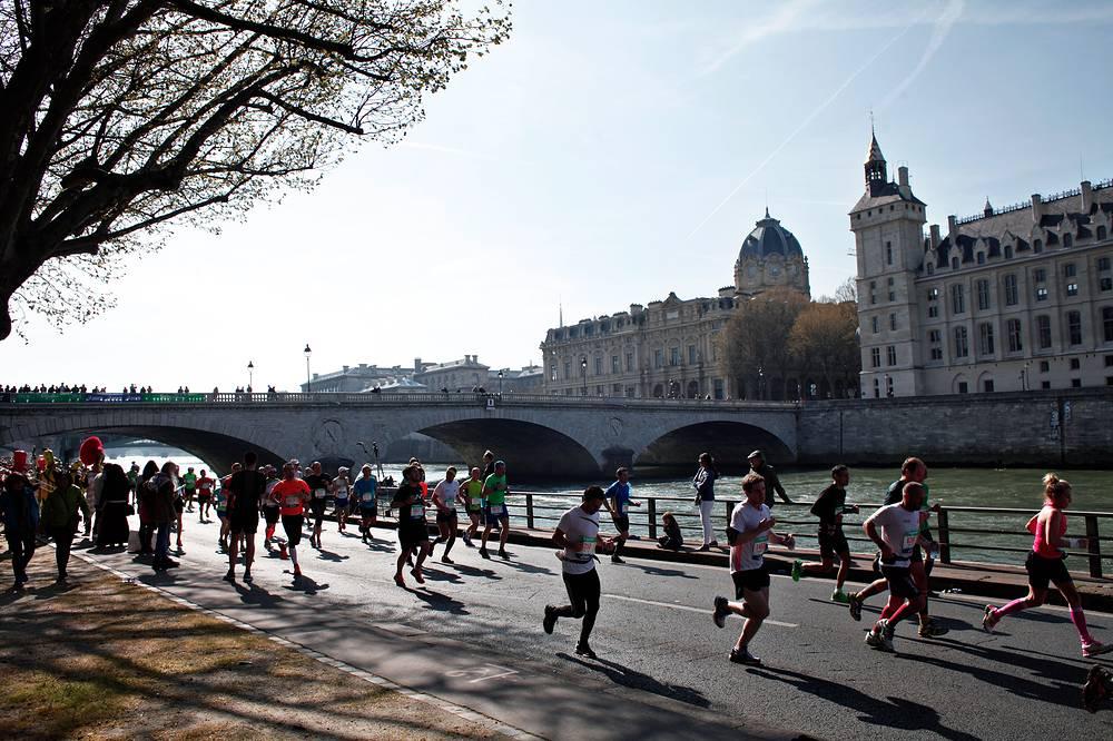 Runners making their way along the Seine river during the Paris Marathon, 2015