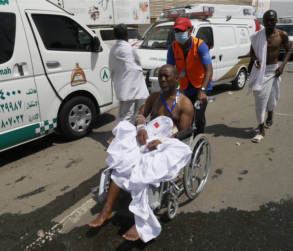 A rescue worker attending to a man injured in Mina, Saudi Arabia