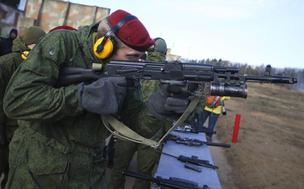Serviceman shooting a grenade gun at Geodezia firing range in Krasnoarmeisk, Moscow region