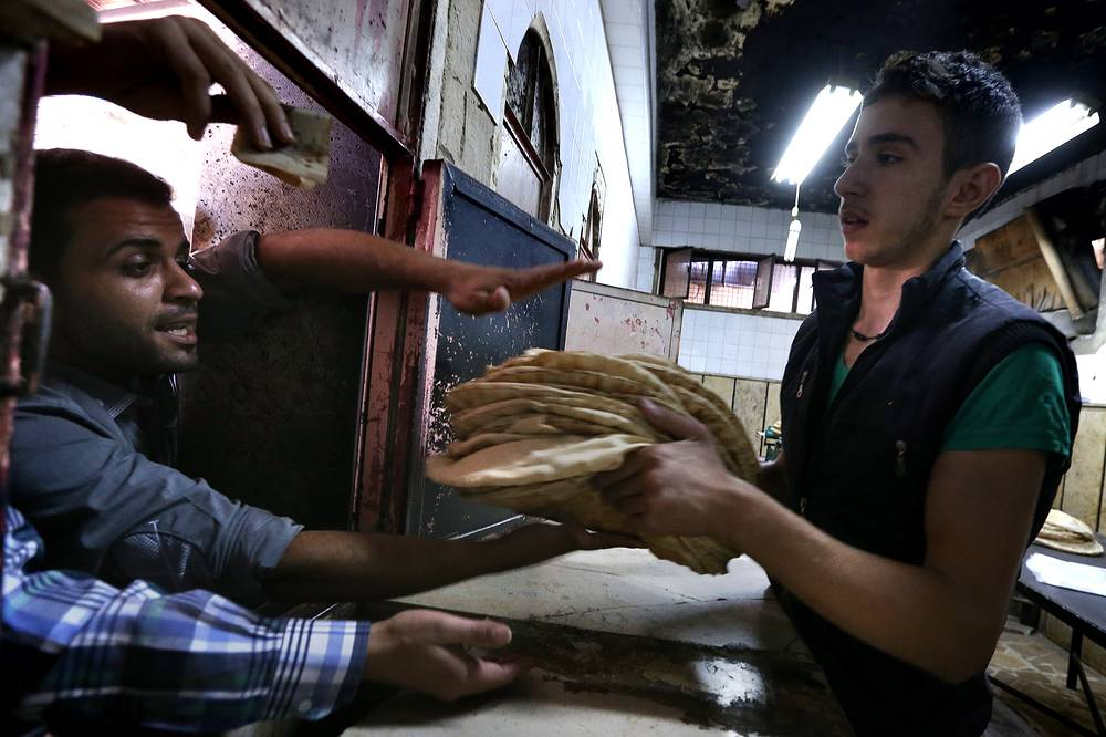 Local residents buying bread