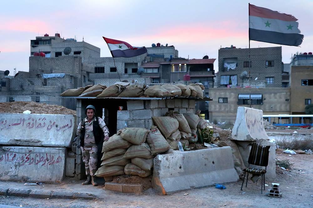 Syrian serviceman in a street in the Dahaniya neighborhood of Damascus