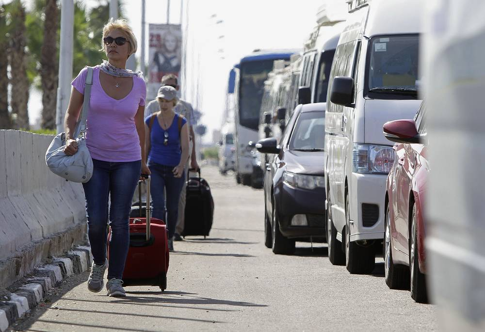 Tourists with their luggage at the Sharm el-Sheikh airport in Egypt