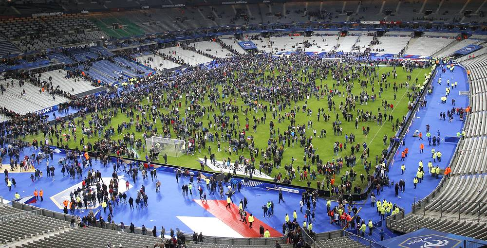 Spectators invading the pitch of the Stade de France stadium after the international friendly soccer France against Germany