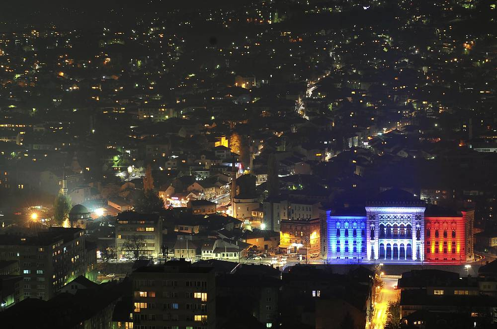 City hall seen illuminated in the colors of French national flag in Sarajevo, Bosnia