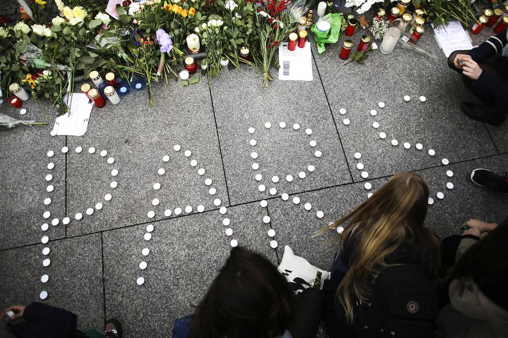 The word Paris formed with candles in front of the French embassy in Berlin, Germany