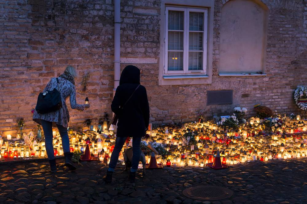 Candles outside the French embassy in Vilnius, Lithuania