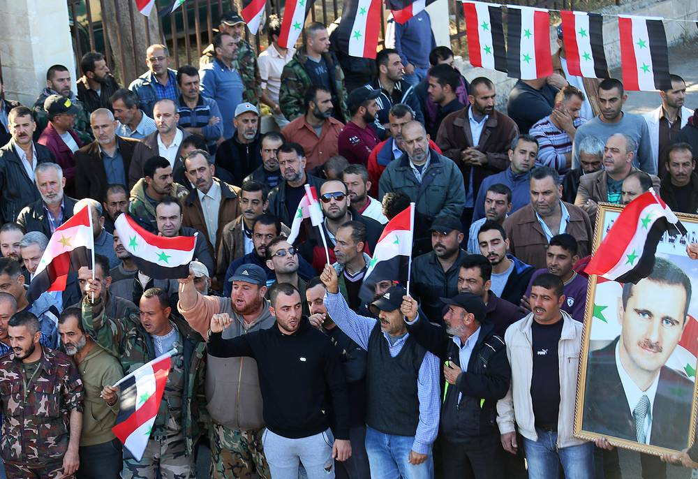 Local residents of Syria's Latakia province after completing training to become full-fledged members of Syria's popular self-defense force