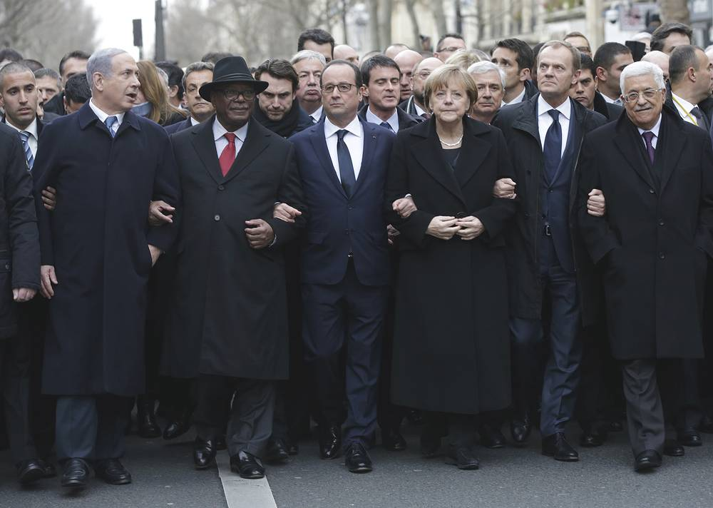 German Chancellor Angela Merkel among world leaders marching at rally in Paris, France, Jan. 11, 2015 following terrorist attack on the Paris offices of satirical magazine Charlie Hebdo