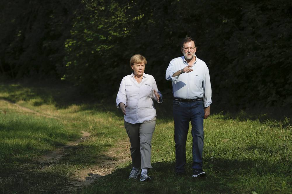 German Chancellor Angela Merkel and Spain's Prime Minister Mariano Rajoy seen during a meeting in the village Meseberg, Germany, August 31, 2015