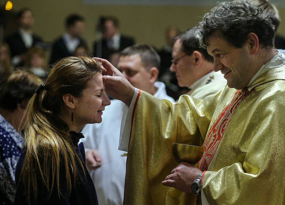 People attending a traditional Christmas Eve Mass at the Cathedral of the Immaculate Conception of the Holy Virgin Mary