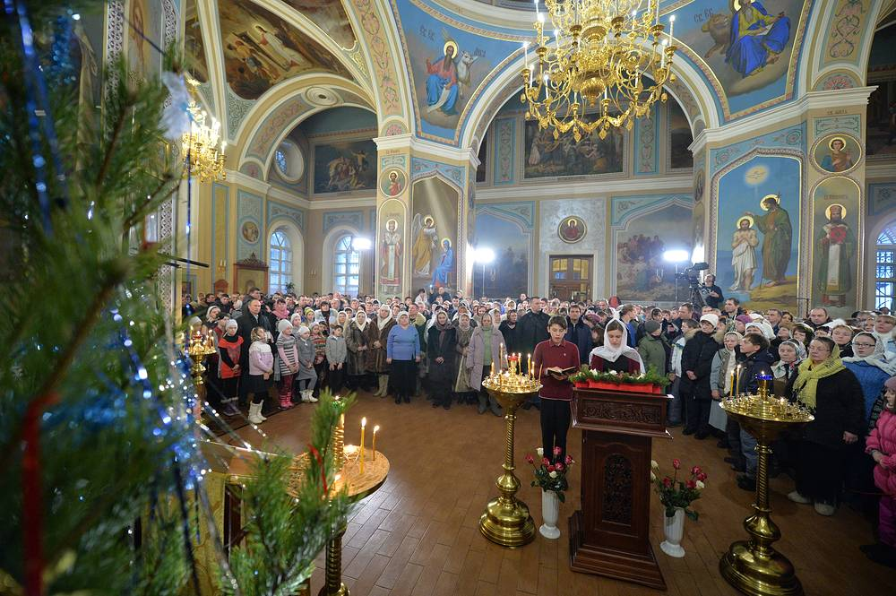 Orthodox Christmas Mass in a church in the village of Turginovo, where the parents of Russian President Vladimir Putin were  baptized
