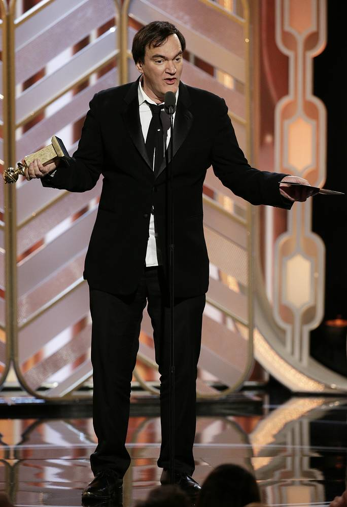 """Director Quentin Tarantino accepting the award for best original score on behalf of Ennio Morricone for the film, """"The Hateful Eight"""""""