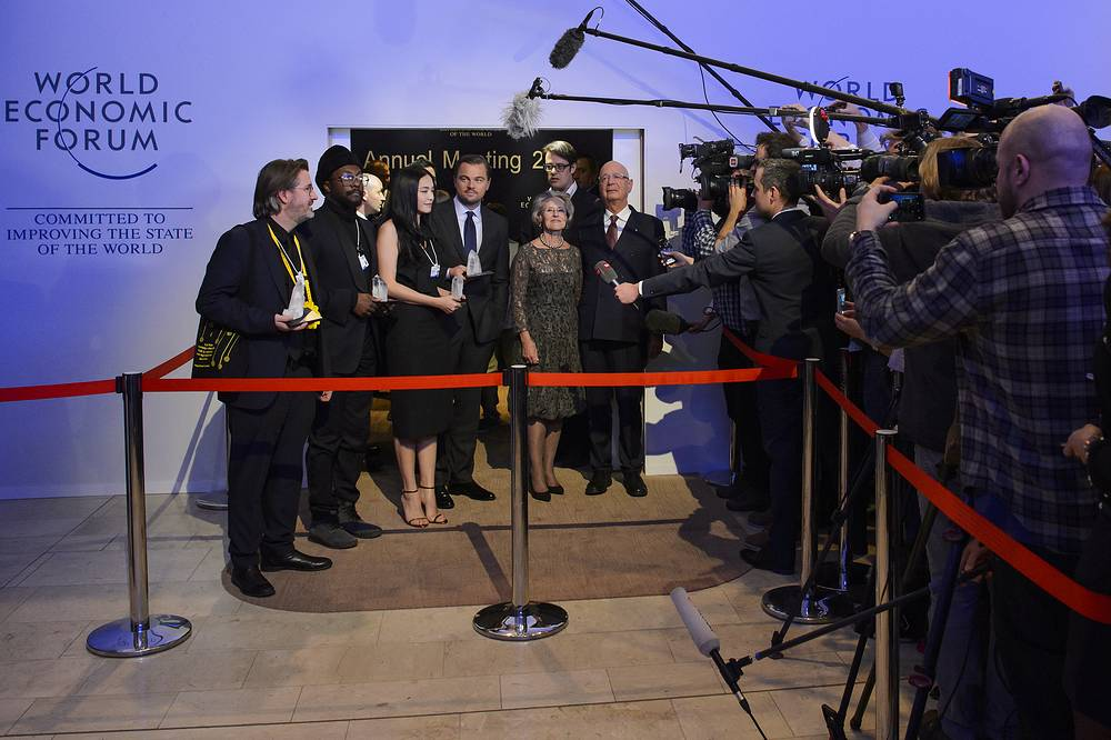 Danish artist Olafur Eliasson, US Rapper Will.i.am, Chinese actress Yao Chen, US actor Leonardo DiCaprio and German Hilde Schwab, CEO and Co-Founder of Schwab Foundation for Social Entrepreneurship, and German Klaus Schwab, founder and president of the World Economic Forum, seen after the Crystal Award Ceremony in Davos