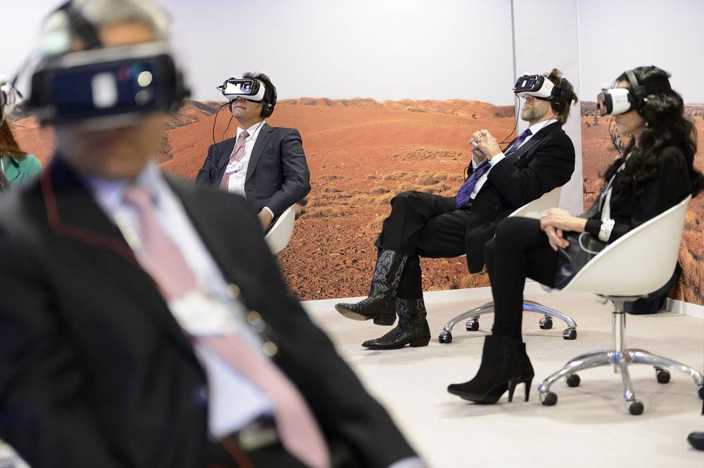 Participants trying out virtual reality glasses watching the world premiere of the virtual reality film 'Collisions' inside the Congress Center the first day of the WEF, in Davos