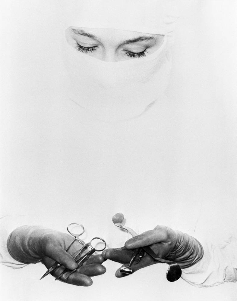 An operating department assistant preparing equipment ahead of a medical operation at Moscow Helmholtz Research Institute of Eye Diseases, 1961